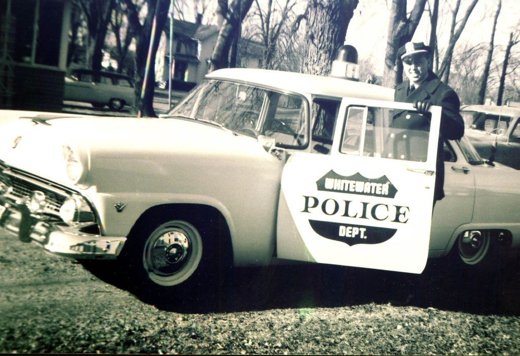 Policeman in an Old Police Car