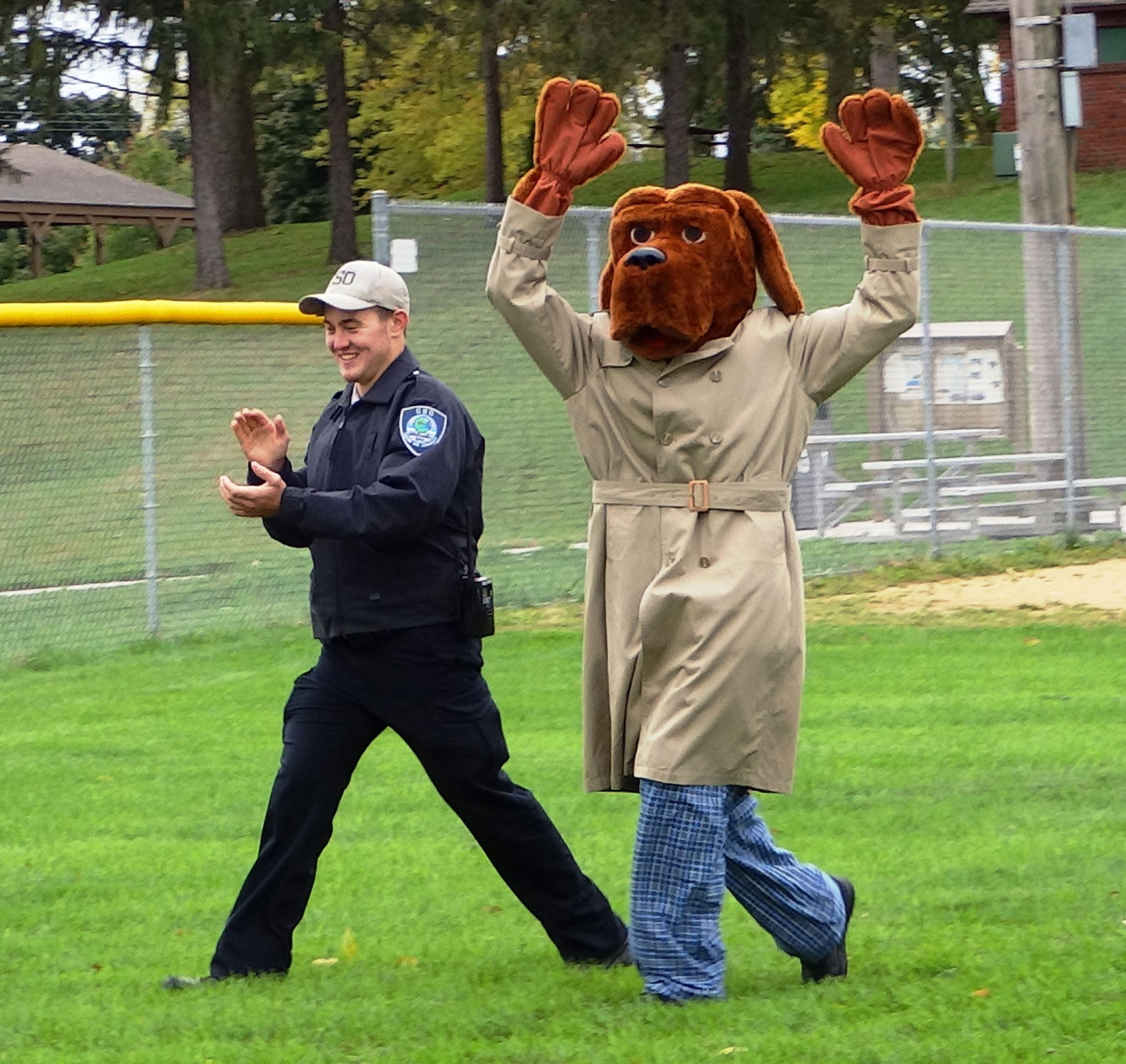 McGruff and a Police Officer Celebrating